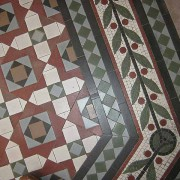 Rictor Norton & David Allen Follow St Pancras Renaissance Hotel  Minton tiles at the bottom of the staircase